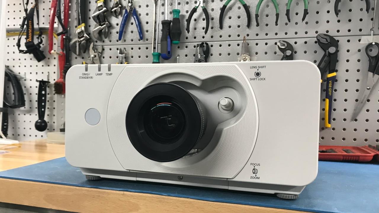 Panasonic projector on bench before repair
