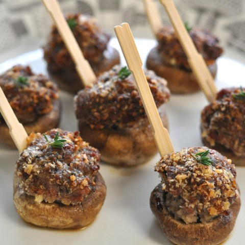 plump mushroom caps stuffed with sausage and breadcrumbs