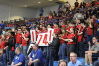 Red Alert Robotics cheers in the stands, attempting to bring the judges' attention to their team.