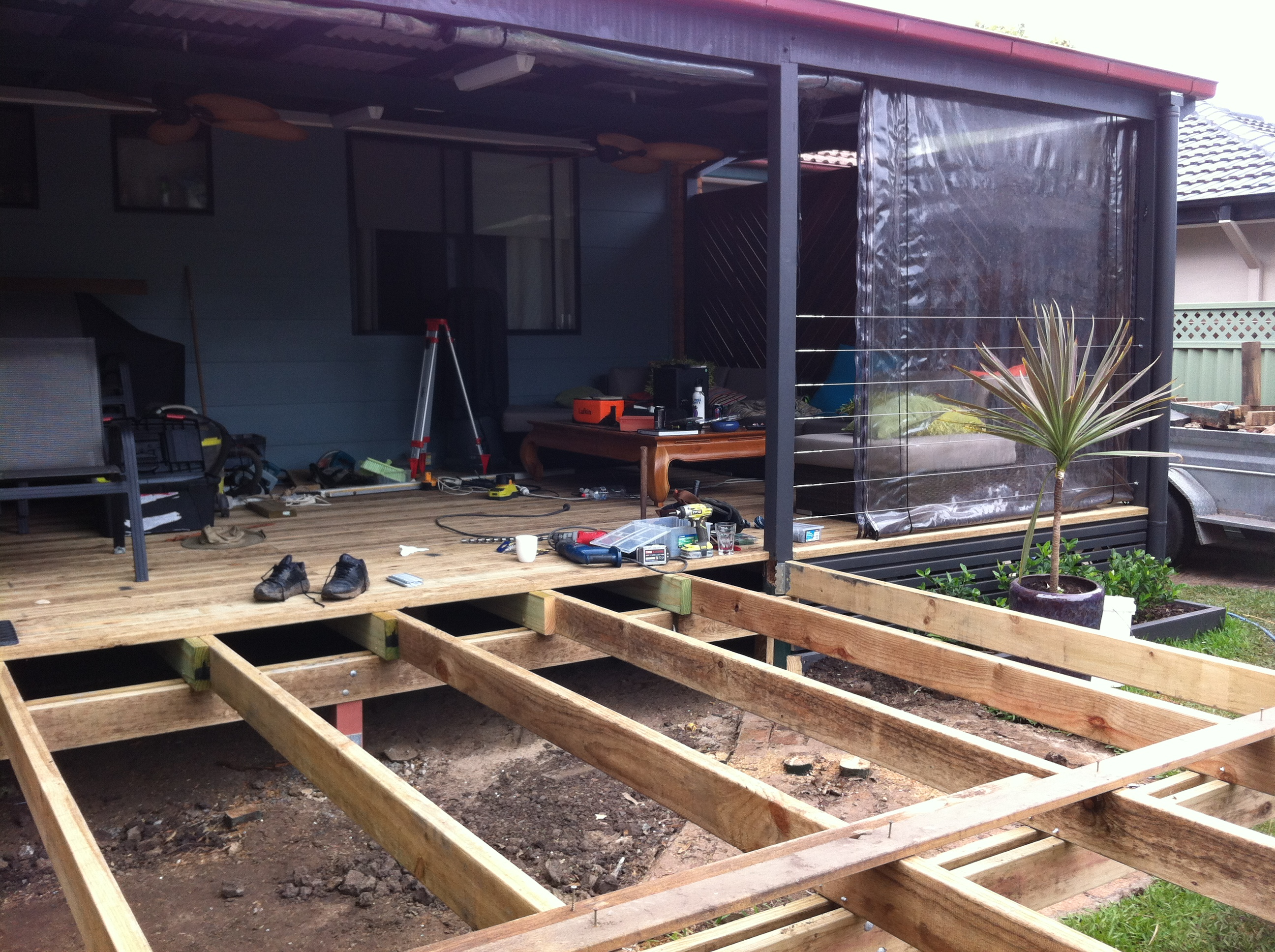 new decking coming through from under roof area