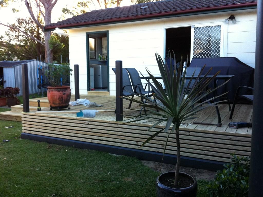 finished deck showing slat side cover & base trim
