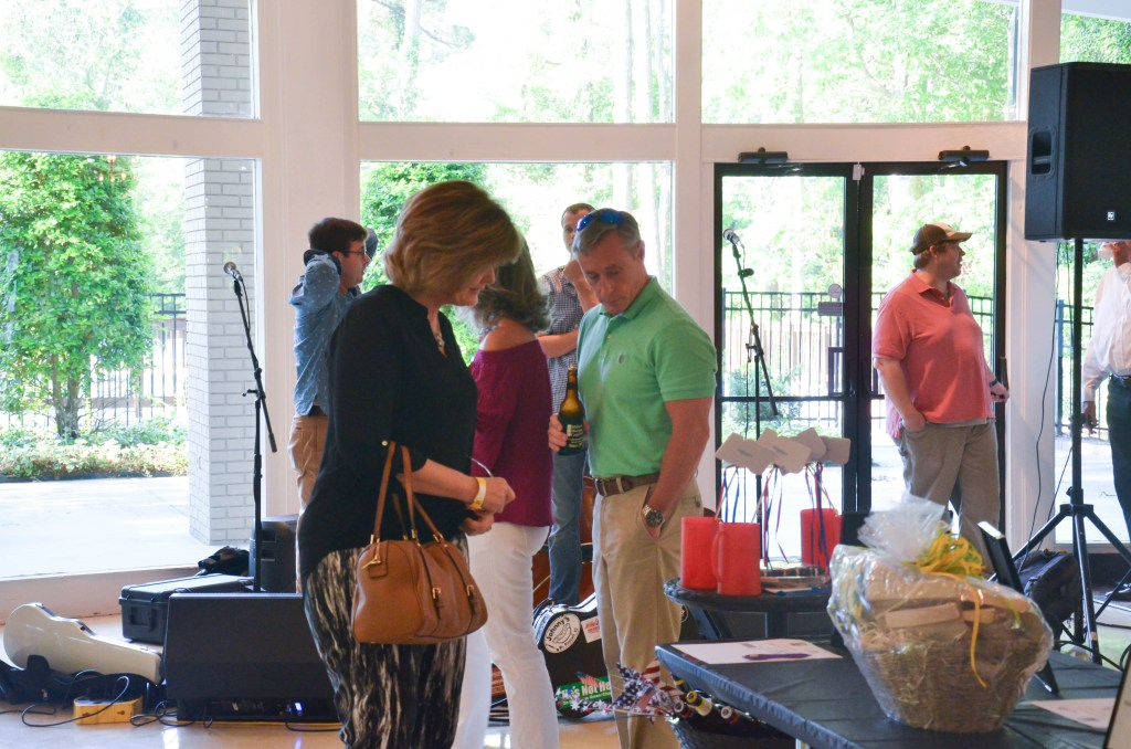 People looking at auction items at RPAC 2017 event.