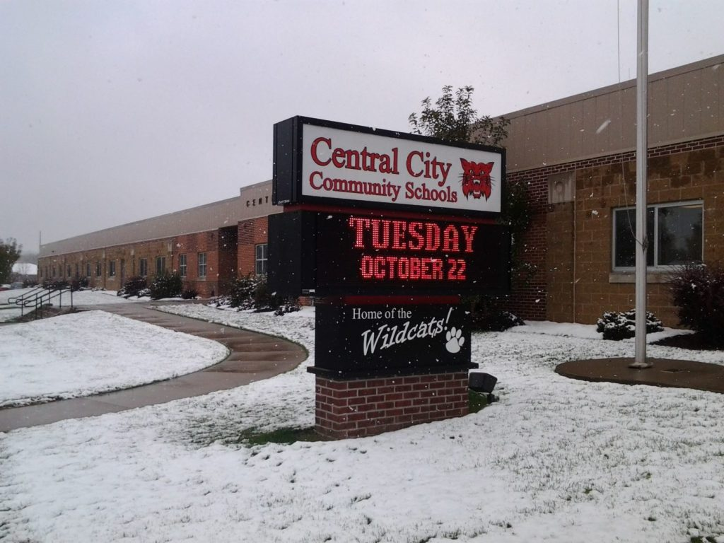 Photo of the Central City Community Schools sign outside of the building in the winter