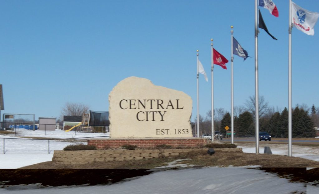 Central City sign and flags