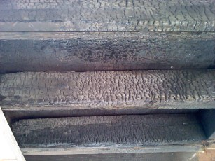 The underside of a deck that a fire occurred on. One Hour rated assemblies like Desert Crete prevent burn through so occupants can escape.