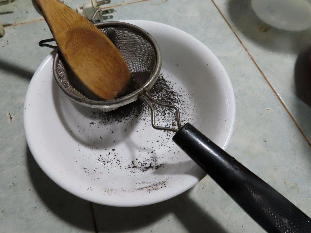 sifting ash through strainer