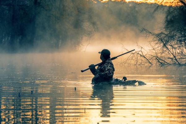 hunter immersed in water while duck hunting in Central Florida