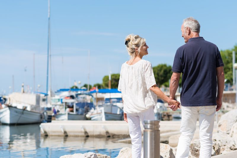 Older Couple looking for a boat at boat club