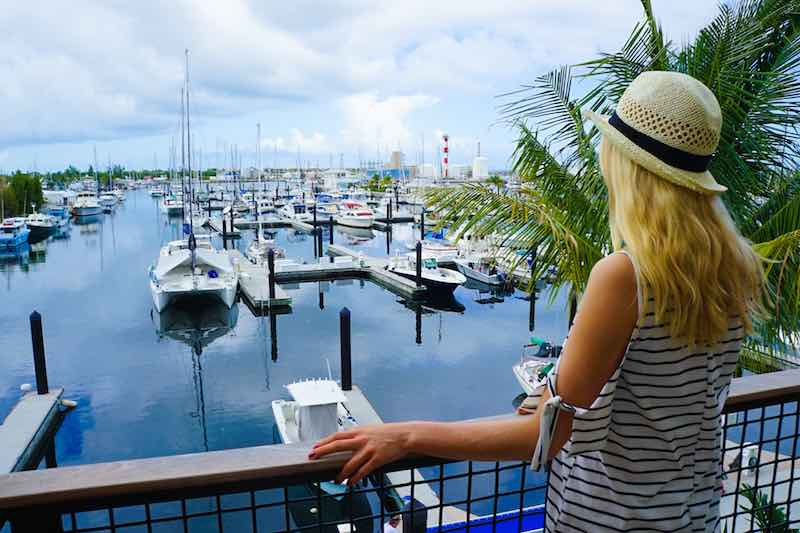 Blond Woman looking at a boat club in Central Florida