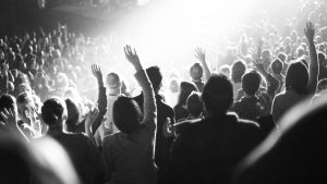 People worshiping with raised hands