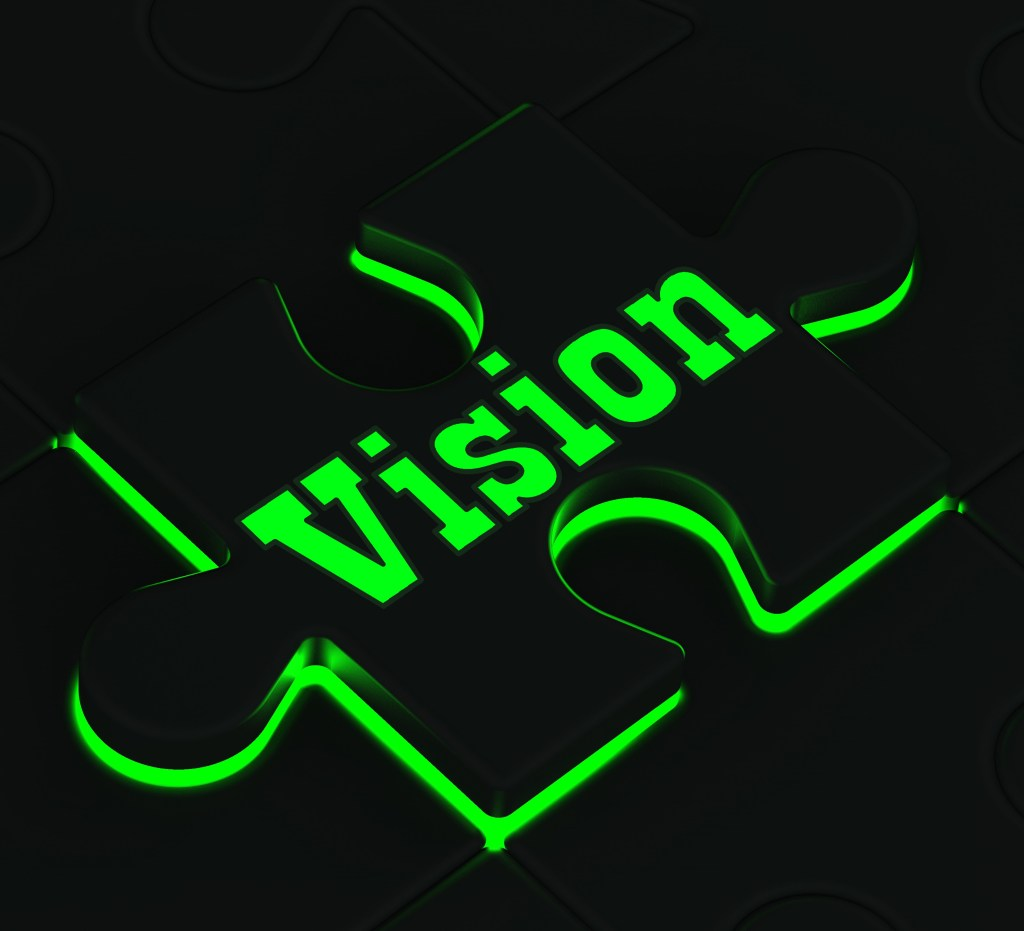 Puzzle piece with the word 'vision' embossed on it