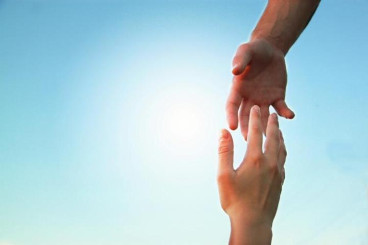 Hands reaching toward each other