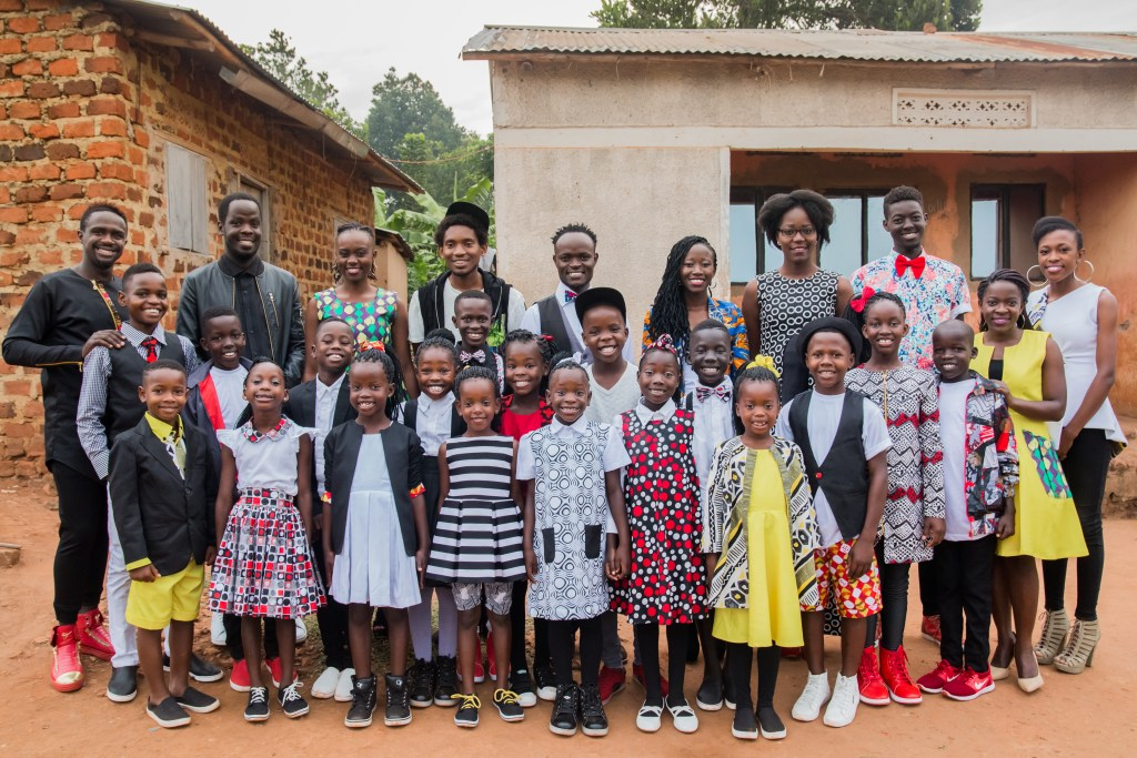 Watoto children and adult chaperones