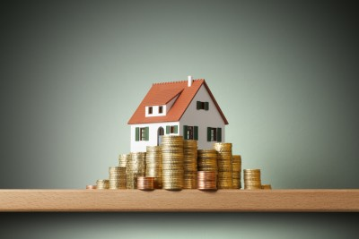Private Rented Sector House on money stack