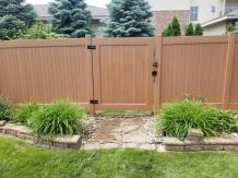 golden-oak-vinyl-privacy-fence-with-gate
