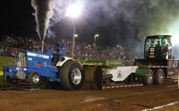 Ford tractor pulling Pioneer Seed Sled