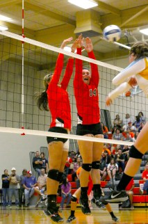 Another block by Sophomore Kiara Skinner and Sophomore Abby Pomrenke. Photo by: Tina Arellano