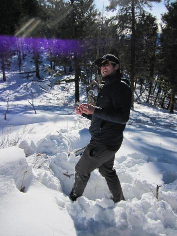 Wells Jones performing one of the tasks of wildlife biologists working on the Winter Wolf Study in the Lamar Valley in YNP