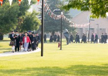 Faculty, professional staff and administrators processional to convocation; led by Ray Price playing the bag pipes.