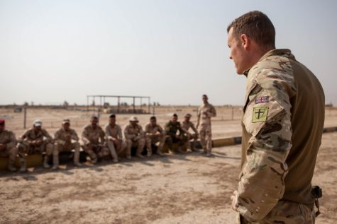A British trainer addresses Iraqi soldiers before they begin practicing an area search at the Besmaya Range Complex, Iraq (Taken by U.S. Army photo by Spc. Christopher Brecht-PUBLIC DOMAIN)