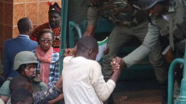 The freed students being helped into a truck by paramilitary force in Bamenda