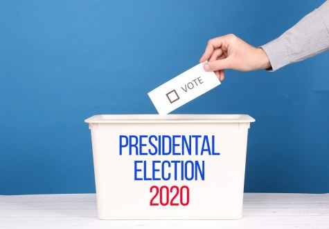 """Man putting his vote in the ballot box for Presidential Election 2020"" by wuestenigel is licensed with CC BY 2.0. To view a copy of this license, visit https://creativecommons.org/licenses/by/2.0/"