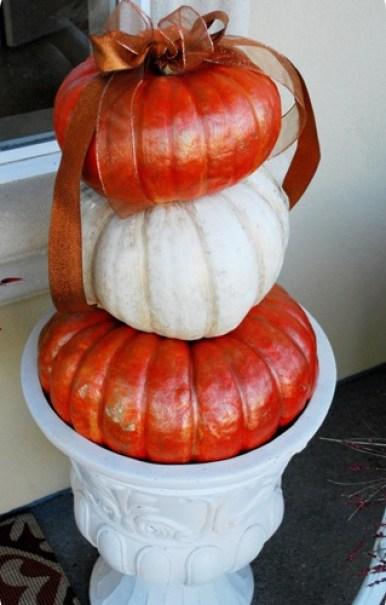 trio of gilded pumpkins in urn