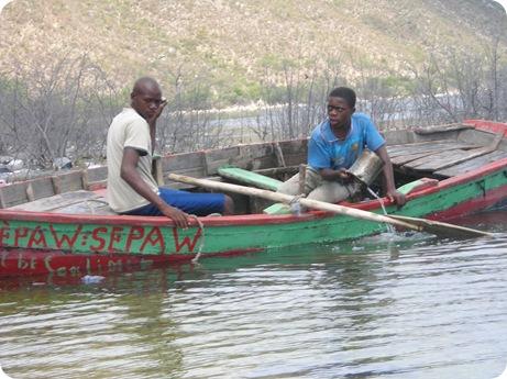 haitian men in canoe