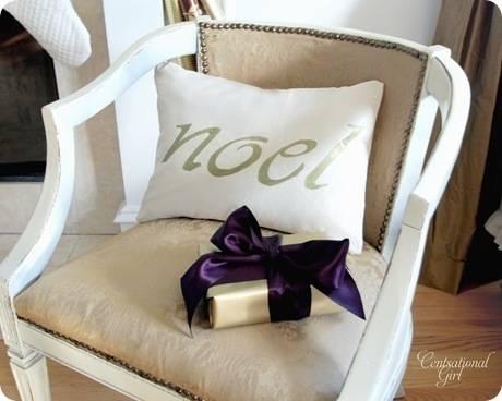 cg noel pillow in chair