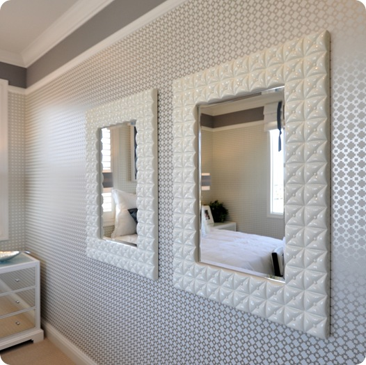 pair of mirrors and wallpaper