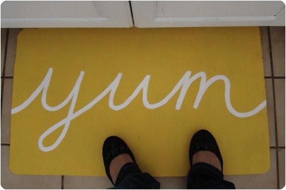 painted yellow kitchen mat