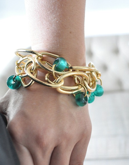 gold link bracelet on wrist