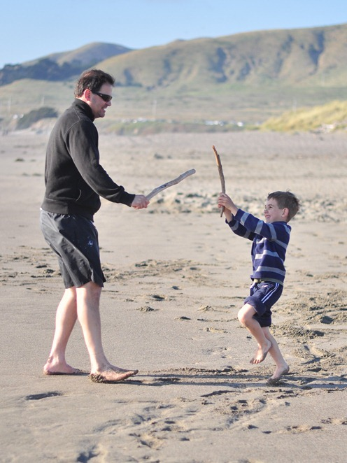 dad and son at beach
