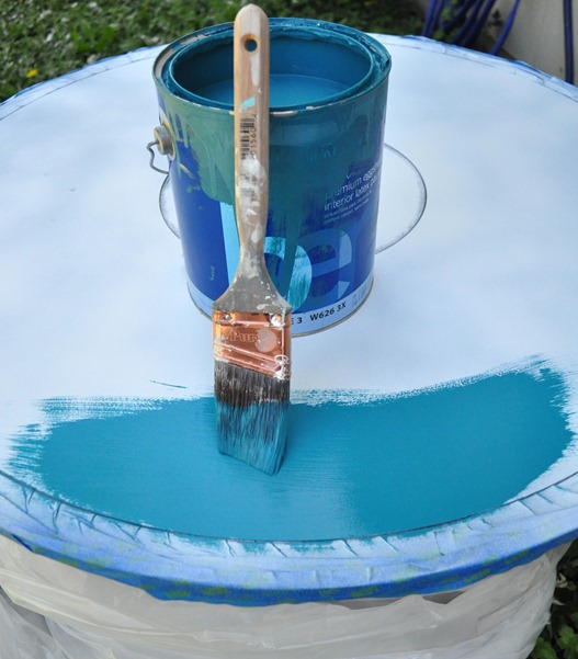 teal paint on table