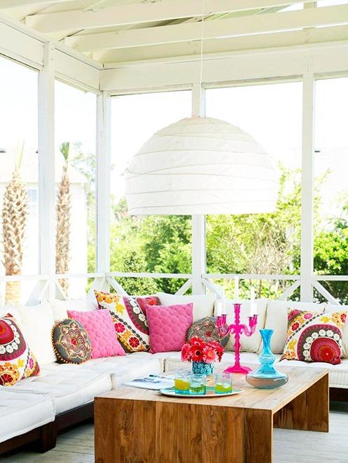 bright colored covered porch bhg