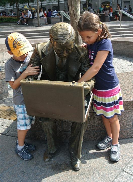 bronze statue and kids