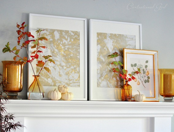 marbled paper and amber bottles on mantel