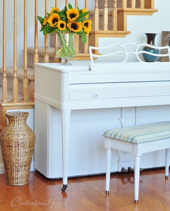 painted white piano by stairs