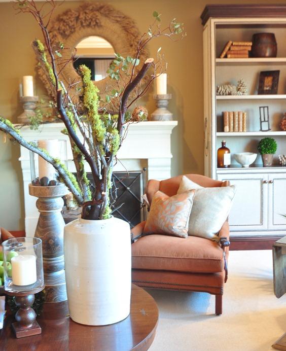 branches in vase in living room