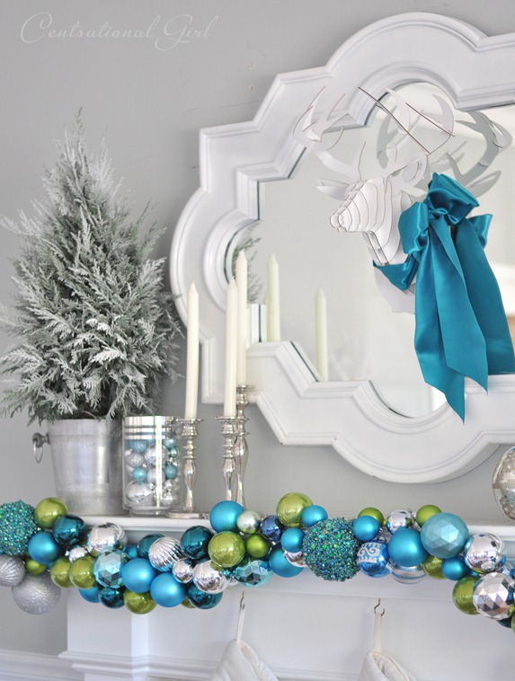 white deer and colorful garland