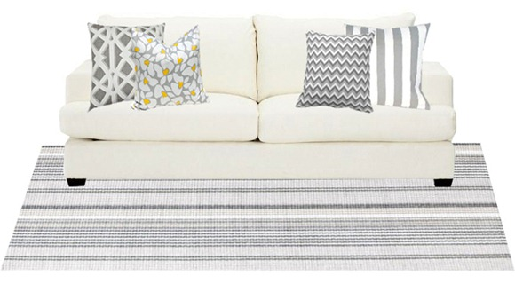 ... Gray And White Rug And Pillows On Sofa