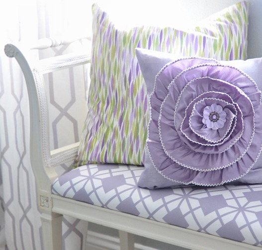 floral pillow on bench