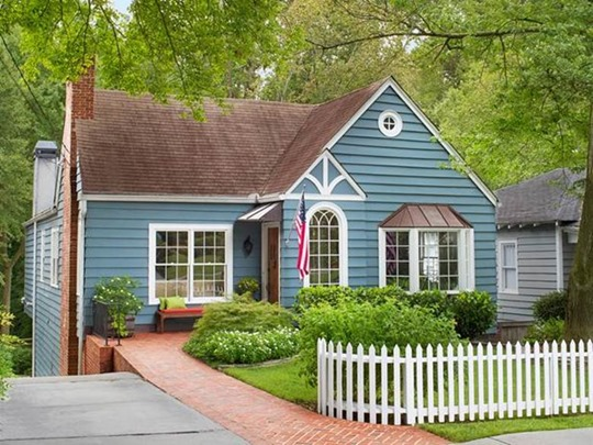 blue house white picket fence