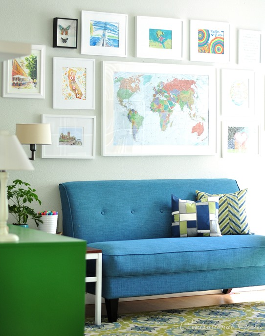 Epic blue sofette and gallery wall above