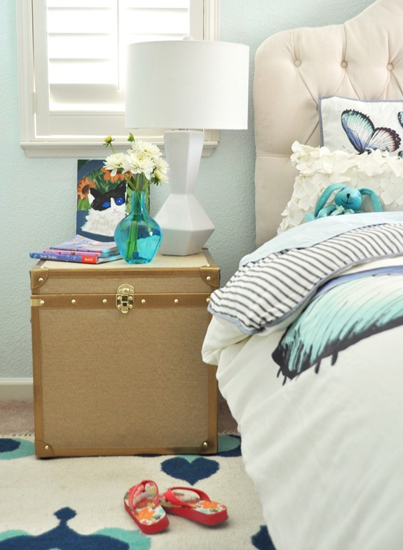 tufted headboard and linen chest nightstand