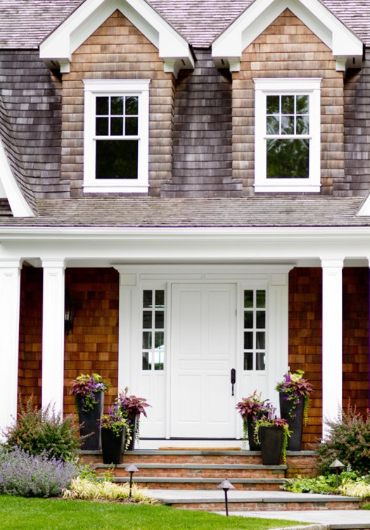 shingle exterior with porch and planters