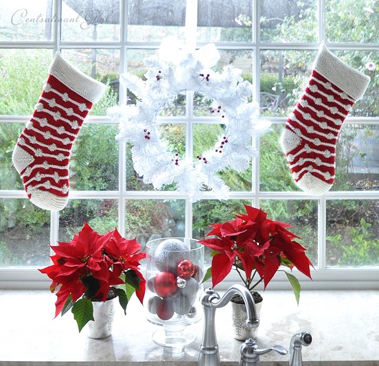 poinsettias and wreath kitchen window
