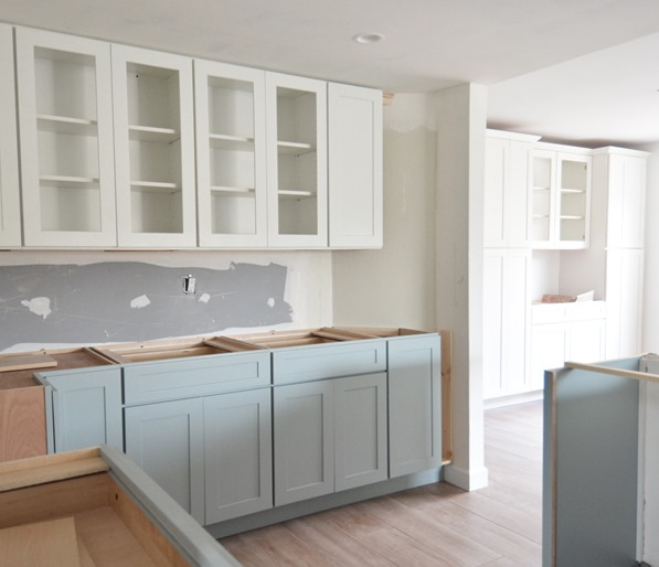 Fabulous  base and upper cabinets to add more storage to the home in the same style of cabinetry and same color as the upper cabinets in the kitchen