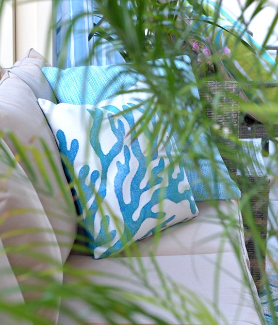 pillows and palm leaves