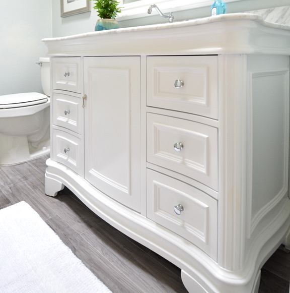 Fancy I love the shapely chrome faucet and the carrara marble top the pull out soft close drawers provide extra storage for toiletries